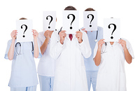 Group Of Doctors With Question Mark Sign