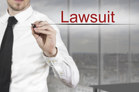 businessman writing in the air lawsuit