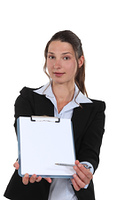 businesswoman holding a notepad and a pen