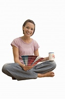 woman holding paint colour charts for decorating, cut out