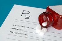 Prescription form, pills and red bottle