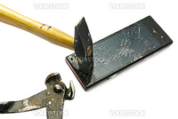 New smart phone smashed by a good hammer.  Studio photo, isolated on white.
