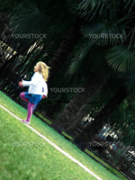 Young girl running in the park