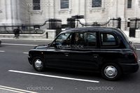 Black London Taxi moving fast