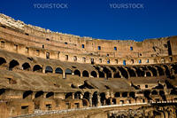 internal photo of the roman colosseum taken with blue sky