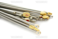 variety of knitting needles in different sizes - both European millimetres and UK sizes