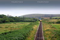 The front end of a diesel train on the Swanage railway in Dorset UK. A front on view of the train on the track shot from a small bridge between Corfe Castle and Swange.