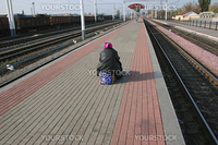 The lonely passenger on a railway platform expecting a train at station the Osnova  Kharkov 15.10.2008