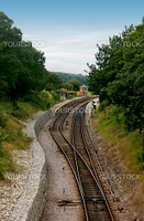 Railway track leading to and from the platform and station at Harmans Cross in Dorset UK. This forms part of the Swanage Steam Railway Network in this area.