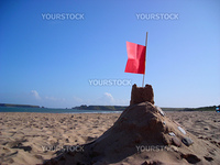 A sand castle on South Beach at Tenby with Caldey Island in the distance.