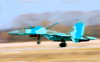 Fighter Su-34 take-off from a airdrome. Panning effect