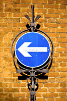 Beautiful vintage toned image of a one way sign against a brick wall in the UK