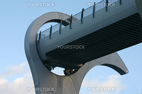 Detail of Falkirk Wheel (rotating boat lift for canal boats between the Forth and Clyde Canal and the Union Canal, Scotland, UK, against cloudy sky.