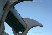 Detail of Falkirk Wheel (rotating boat lift for canal boats between the Forth and Clyde Canal and the Union Canal, Scotland, UK, against blue sky.