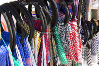A rack of Keffieyeh, the Arabian headdress, hanging in a market stall near Petra, Jordan.