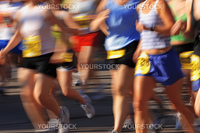 Runners streak past the camera in a marathon