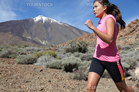 Runner. Woman running outside in beautiful nature.