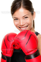 Boxer woman. Boxing fitness woman smiling happy wearing red boxing gloves. Portrait of sporty fit Asian Caucasian model on white background.