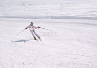 Beautiful skier on the downhill in sunny day