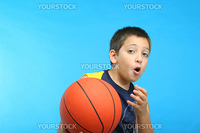 Boy playing basketball blue background. From my sport series.