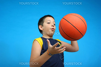 Boy playing basketball isolated. blue background. From my sport series.