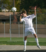 Soccer player hits ball with head.