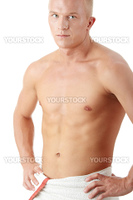 Muscular sexy man wrapped in the towel isolated on white