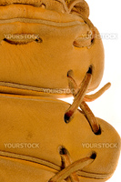 A baseball glove or mitt close up series of its leather deatils
