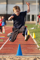 a cute jumping young kid