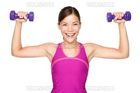 Fitness woman lifting weights smiling happy isolated on white background. Fit sporty mixed race Asian Caucasian female fitness model.
