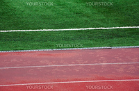 Rain before match Marsielle vs Legia. Wet field and athletic track.