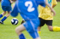 Soccer players with blue and yellow shirts
