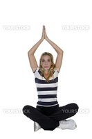 young woman in yoga pose against white background