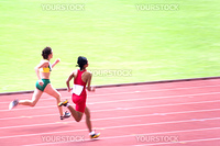 Visually impaired athletes competing in a Women's 100 meters race.