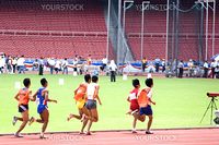 Blind athletes competing in a Men's 1500 meters race. Each athlete is seen here running in tandem with their guides.