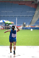 A participant in a women's javelin throw event. This event was carried out in light drizzle.