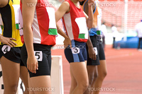 Image of female 100 meter athletes awaiting the start of their race.
