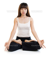 Young Asian woman having meditation with lotus position on white background.