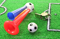 colorful soccer horn with football and whistle on a soccer field