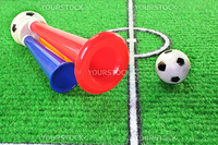 colorful soccer horn with football on a soccer field