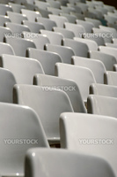 emtpy seating at a football stadium, white