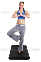 Isolated young yoga fitness woman