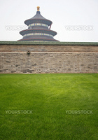 Temple of Heaven pagoda and wall in Beijing. Green grass in the foreground.