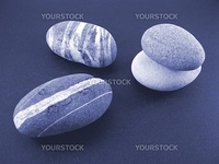 various pebbles with stripes to illustrate zen conscept