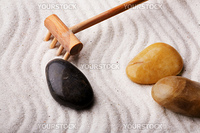 An oriental rock garden background with stones and sand