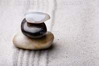 tower of rocks in a sand zen rock garden