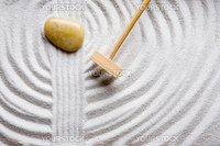 A rake in a zen rock garden, preparing the sand