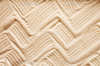 A zig zag background pattern in sand