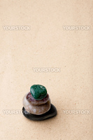 A tower of rocks in a very minimalist zen rock garden
