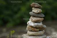 A zen-like picture of a stack of rocks with a blurred background